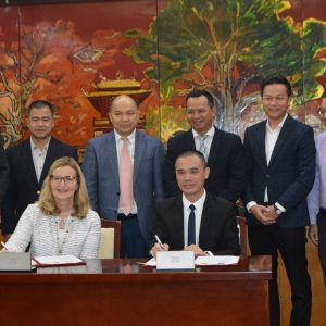 Saint Rose President Carolyn J. Stefanco signing an agreement with officials from Hanoi University in Vietnam