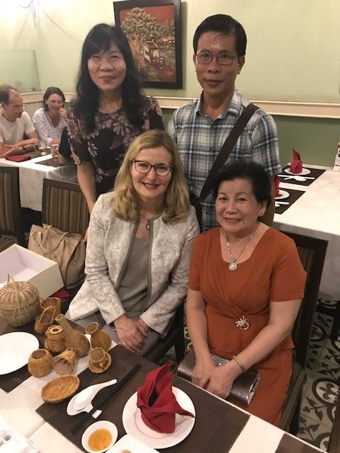 President Carolyn J. Stefanco with the family of a current Saint Rose student in Vietnam