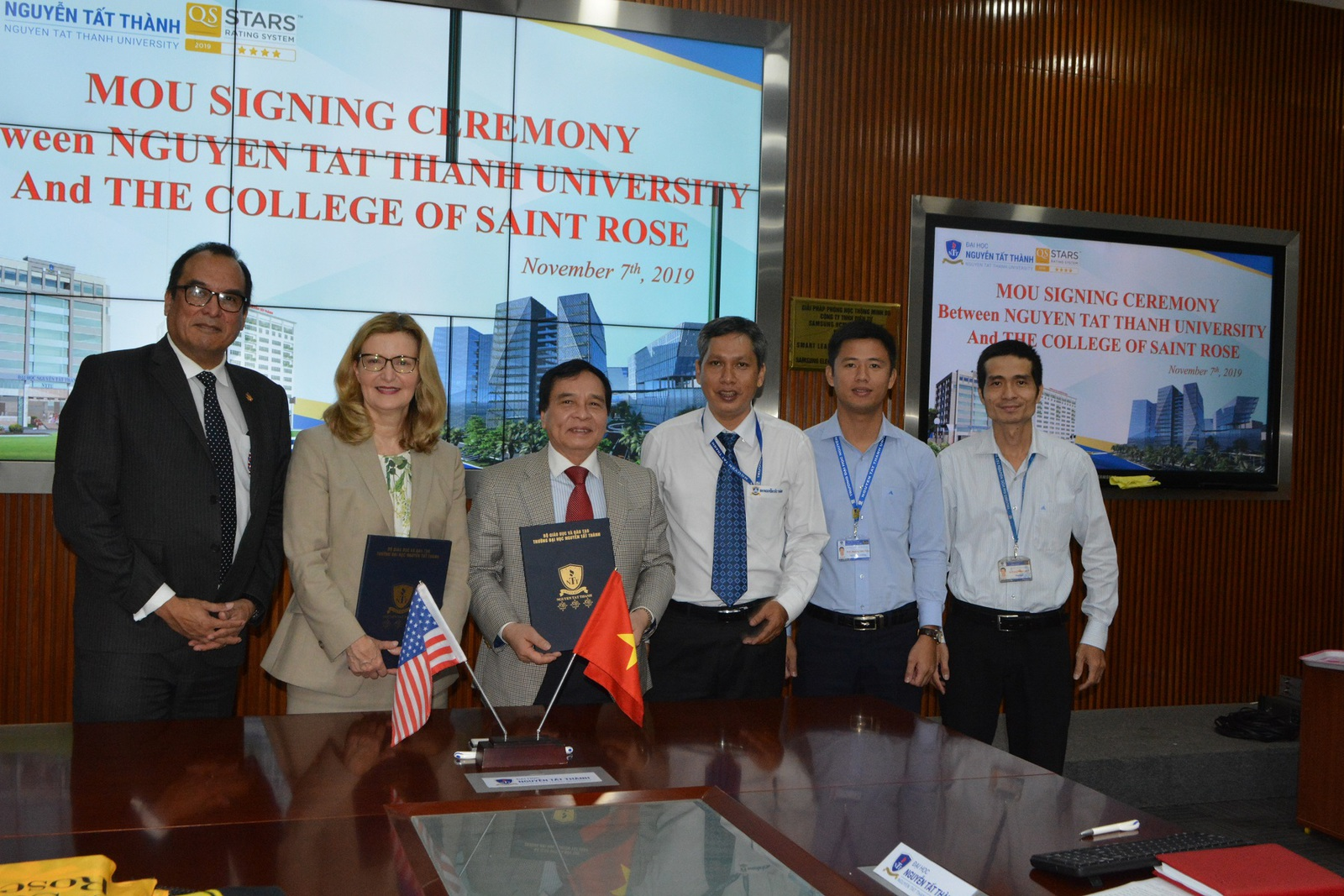 Saint Rose President Carolyn J. Stefanco at the memorandum of understanding signing ceremony with Nguyen Tat Thanh University officials in Vietnam.
