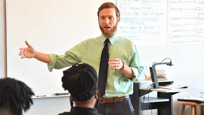 Steven Gamache G'10 teaching in his New Orleans classroom