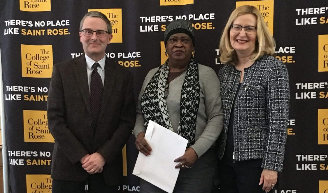 Roberta Smith, custodian, who was recognized for 35 years of service to the College, with Associate Vice President for Human Resources and Risk Management Jeffrey Knapp and Saint Rose President Carolyn J. Stefanco.