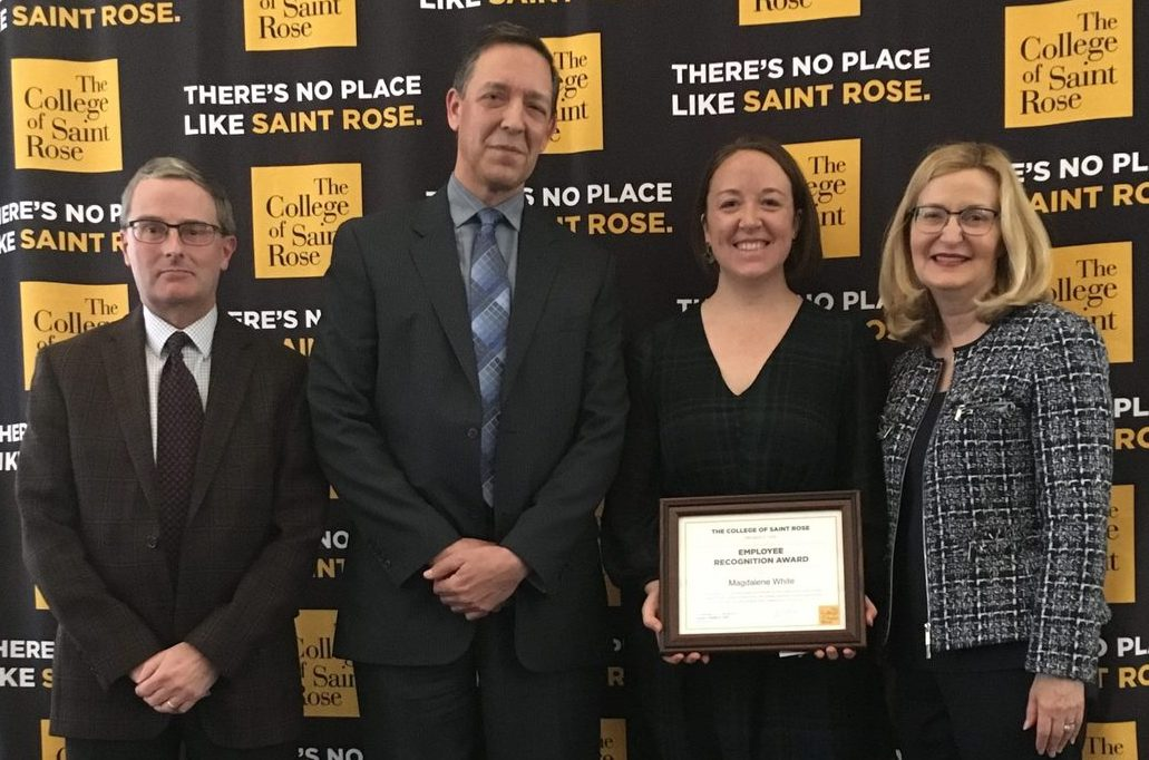 Award recipient Magdalene White, assistant director of graduate admissions, with nominator Daniel Gallagher, assistant vice president for graduate admissions; Jeffrey Knapp, associate vice president for human resources and risk management, and Saint Rose President Carolyn J. Stefanco.