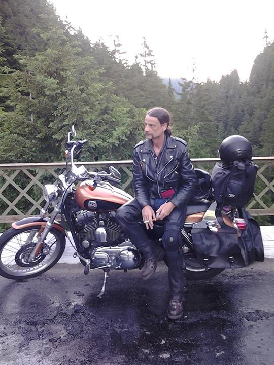 leather forest bike pose