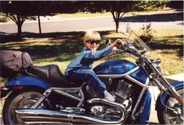 young boy on motorcycle