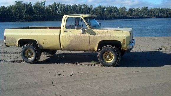 old yellow truck on beach