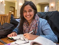 Student smiling while studying at SU library