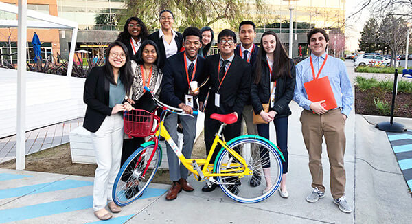 Students pose in front of Google headquarters
