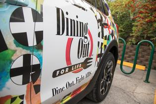 """Spokesperson Mondo Guerra designed a """"Pozitivity"""" custom-wrapped vehicle (pictured) for Subaru and Dining Out For Life."""