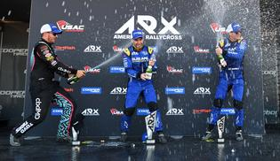 Chris Atkinson and Patrik Sandell spray champagne on the podium after Atkinson's thrilling win on Saturday.