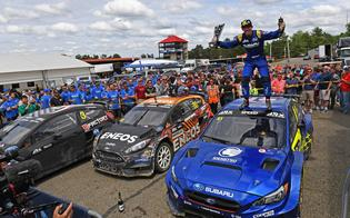 The Vermont SportsCar team shares a moment of celebration with overall winner Scott Speed and his WRX STI rallycross car during the ARX Mid-Ohio podium ceremony.