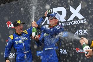 Scott Speed and Patrik Sandell enjoy the celebration after taking a 1-2 finish at Sunday's final race.
