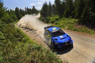 Oliver Solberg and Denis Giraudet were held up by a flat tire but fought back to earn ten out of thirteen overall stage wins and finish fifth overall at New England Forest Rally.
