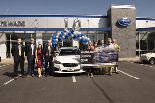 Subaru sells 10-millionth vehicle in the U.S. (L to R) Andrew Sidel (SOA), David Airington (SOA), Jessica Tiedeken (SOA), Barry Jellick (SOA), Rachel Harmon (customer), Marianne Harmon (customer), Kirk Schneider (owner, Nate Wade Subaru), Dr. Craig Harmon (new Impreza owner), Rob Berman (sales manager)