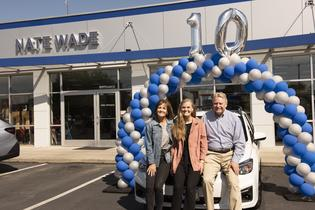 Subaru sells 10-millionth vehicle in the U.S. (L to R) Marianne Harmon (customer), Rachel Harmon (customer), Dr. Craig Harmon (new Impreza owner)