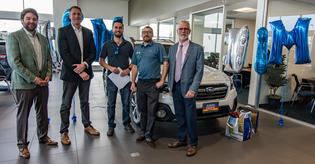 Subaru sells two-millionth Outback in the U.S. (L to R) Sean Sullivan (president, Subaru Pacific) Andrew Simpson (Outback owner), Tim Tagye (Subaru of America), James Miller (sales consultant, Subaru Pacific) and Frank Ceccacci (Subaru of America)