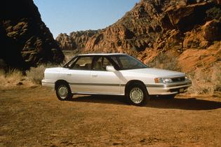 "Subaru Legacy Production: 1990-Present Powered by a 2.2-liter BOXER engine with 130 hp. and 137 lb-ft. of torque   First model to relocate the spare tire from the engine compartment to the trunk   Available in standard, L or LS trim levels in either sedan or wagon   5-speed manual and ""Hill Holder"" was standard   Four-wheel disc brakes and multi-point fuel injection were also standard equipment"