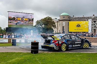 """Pastrana and the Subaru team also participated in """"Driftkhana"""" runs up the hill, with the Airslayer STI shredding tires for the fans in full Gymkhana style."""