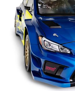 The STI logo features prominently on the front bumper, roof scoop, rear wing and trunklid vent panel.