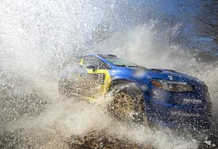 David Higgins and co-driver Craig Drew blast through a water crossing at the Rally in the 100 Acre Wood in their 2019 Subaru WRX STI. Photo credit: Ben Haulenbeek / Subaru Motorsports USA