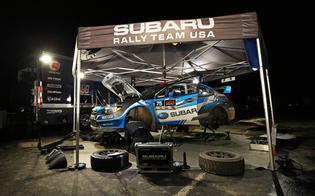 The Subaru Rally Team USA technicians performing service on the #75 Subaru WRX STIPhoto Credit:Matthew Stryker / Subaru Rally Team USA