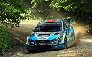 David Higgins setting his Subaru WRX STI for a high speed turn at the Ojibwe Forests RallyPhoto credit: Matthew Stryker / Subaru Rally Team USA