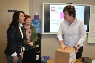 Cream teacher Karen Santarsiero receives new school supplies from Subaru staff