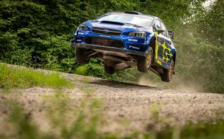 Travis Pastrana and co-driver Rhianon Gelsomino take flight over one of Ojibwe Forests Rally's big crests.