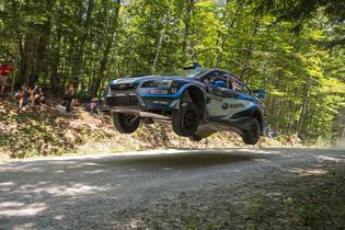 Higgins and Drew fly through the forest at NEFR. Photo Credit: Lars Gange / Subaru Rally Team USA