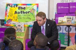 Subaru of America SVP of Marketing Alan Bethke reads to Camden third graders during a recent donation of more than 3,000 science books to Camden schools. Photo credit: Mark Nesbitt courtesy of iNTVNETWORK, LLC 2017.