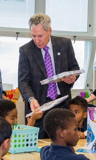 Subaru of America President Tom Doll gives out new books to Camden third graders, as part of Subaru's donation of 3,000+ science books to Camden schools. Photo credit: Mark Nesbitt courtesy of iNTVNETWORK, LLC 2017