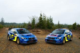 Pastrana and Semenuk's Subaru rally cars patiently await before the action takes place in Ohio.