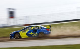 The blue and gold WRX STI of Patrik Sandell blasts through the dirt at the inaugural ARX round at Mid-Ohio.