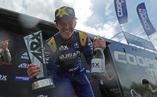 Scott Speed celebrates his first victory with Subaru Motorsports USA on the podium at the Mid-Ohio.