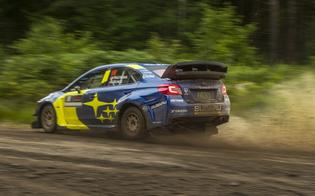 Mud and rocks spray out from behind Travis Patrana's #199 WRX STI during testing ahead of SOFR.