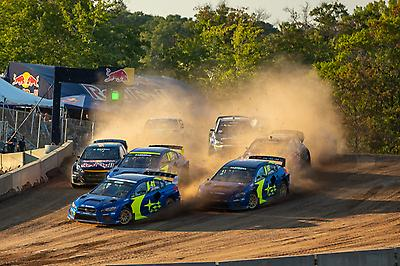 The thrilling final race briefly saw the three blue and gold Subaru WRX STI's sitting first, second and third—although a puncture would eventually relegate Bakkerud to seventh.