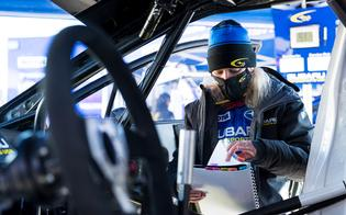 Co-driver Rhianon Gelsomino goes over stage notes in pre-event service before heading out to the start.