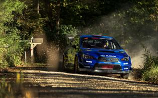 Travis Pastrana dropped back of the leaders after a pair of tire punctures on the third stage, but kept the pace up on the rally's second day, taking a stage win on SS7.