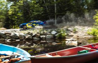 The #1 WRX STI of Higgins and Drew skirts the edge of a pond on the way to victory at New England Forest Rally.