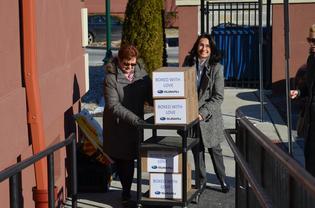 Subaru staff deliver school supplies to Cream School at its new location in North Camden