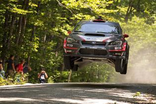 Travis Pastrana catches air at NEFR. Photo Credit: Lars Gange / Subaru Rally Team USA
