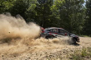 Travis Pastrana slides his Subaru on the rough roads of the New England Forest Rally. Photo Credit: Lars Gange / Subaru Rally Team USA