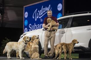 Tom Doll, president and chief operating officer for Subaru of America, Inc., unveils the all-new 2019 Ascent SUV at the 2017 Los Angeles Auto Show with the help of The Barkleys four-legged family.