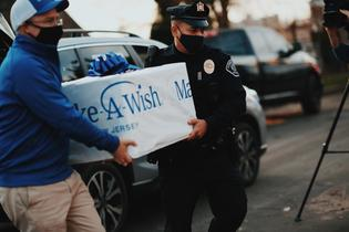 Eight-year-old Antonio, who battlesacritical, life-threatening illness, was on the receiving end ofaSubaru convoy delivering shopping spreewishitems in Camden, NJ. Photo credit:Make-A-Wish