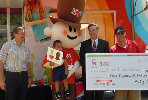 Indy Hunger Network represented by Dave Miner and Glenn Moehling accepted a generous $5,000 donation from the Arby's Foundation.