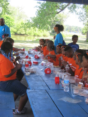Kids enjoying their meals at Gustafson Park.
