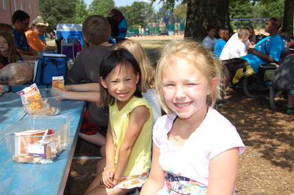Kids enjoying their meals at Christian Park.