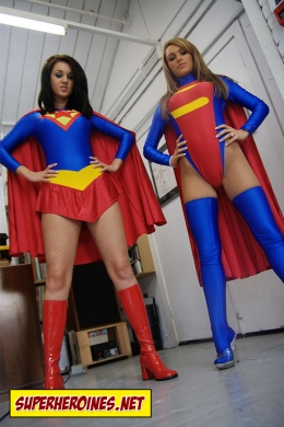 Gemma Massey and Tiffany White in superheroine costumes