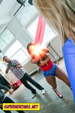 Supergirl blasts her heat vision at Wonder Woman