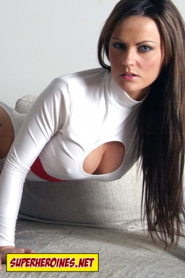 Jasmine Sinclair leaning over in Superheroine costume