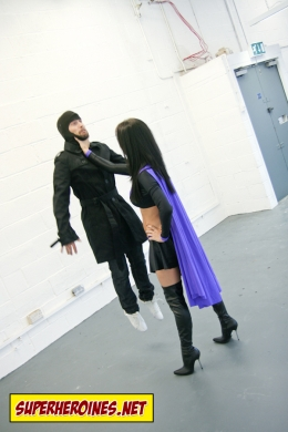 Superheroine Emma Glover picking a man up by his throat